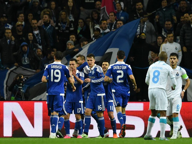 Dynamo Kiev's players (Blue jerseys) celebrate after scoring the opening goal during the UEFA Champions League Group G football match FC Porto vs FC Dynamo Kyiv at the Dragao stadium in Porto on November 24, 2015