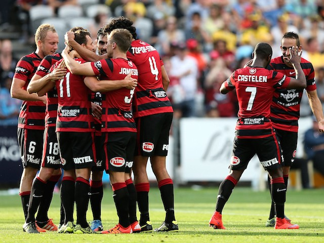 Wanderers team mates celebrate a goal during the round eight A-League match between the Central Coast Mariners and the Western Sydney Wanderers at Central Coast Stadium on November 29, 2015 in Gosford, Australia.