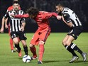 Paris Saint-Germain's French midfielder Adrien Rabiot (L) vies with Angers' Moroccan midfielder Romain Saiss during the French L1 football match between Angers (SCO) and Paris Saint-Germain (PSG), on December 1, 2015, at the Jean Bouin stadium, in Angers,