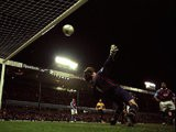 Dion Dublin of Aston Villa beats David Seaman of Arsenal to score the winner in the FA Carling Premiership match at Villa Park in Birmingham, England. Villa won 3-2.