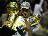 Kobe Bryant of the Los Angeles Lakers celebrates victory following Game 5 of the NBA Finals against the Orlando Magic at Amway Arena on June 14, 2009 in Orlando, Florida. The Lakers won the National Basketball Association championships defeating Orlando 9
