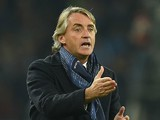Internazonale Milano's coach Roberto Mancini gestures during the Serie A match between SSC Napoli and FC Internazionale Milano at Stadio San Paolo on November 30, 2015 in Naples, Italy.