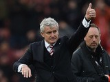 Stoke City's Welsh manager Mark Hughes gestures to the fans following the English Premier League football match between Stoke City and Manchester City at the Britannia Stadium in Stoke-on-Trent, central England on December 5, 2015