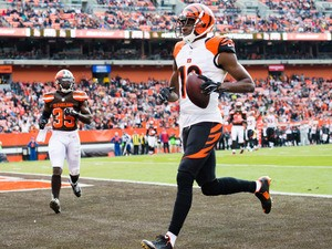Wide receiver A.J. Green #18 of the Cincinnati Bengals scores a touchdown during the first half against the Cleveland Browns at FirstEnergy Stadium on December 6, 2015