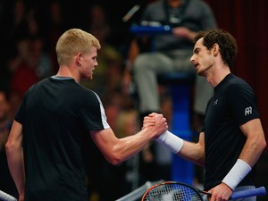 Kyle Edmund of Great Britain (L) shakes hands with Andy Murray of Great Britain (R) after victory in his Tie Break Tennis singles match on day four of the Statoil Masters Tennis at the Royal Albert Hall on December 5, 2015 in London, England.