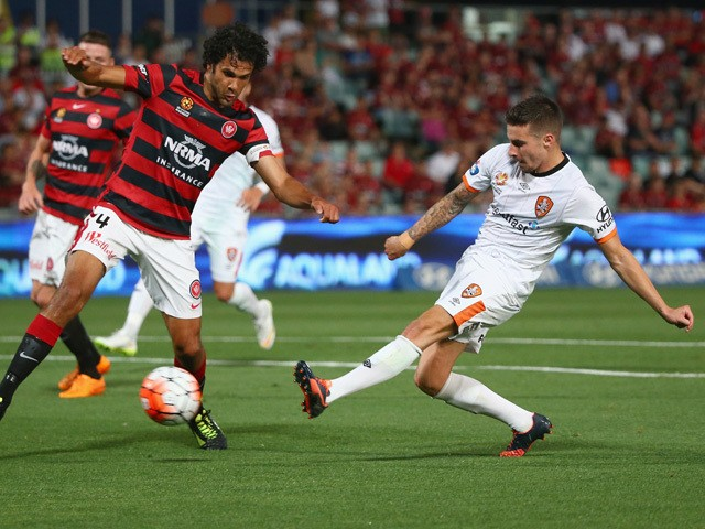 Nikolai Topor-Stanley of the Wanderers fails to block the shot of Jamie Maclaren of the Roar as he scores a goal during the round nine A-League match between the Western Sydney Wanderers and the Brisbane Roar at Pirtek Stadium on December 5, 2015