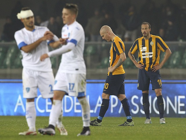 Emil Hallfredsson (2nd R) and Evangelos Moras (R) of Hellas Verona FC show their dejection at the end of the Serie A match between Hellas Verona FC and Empoli FC at Stadio Marc'Antonio Bentegodi on December 6, 2015 in Verona, Italy.
