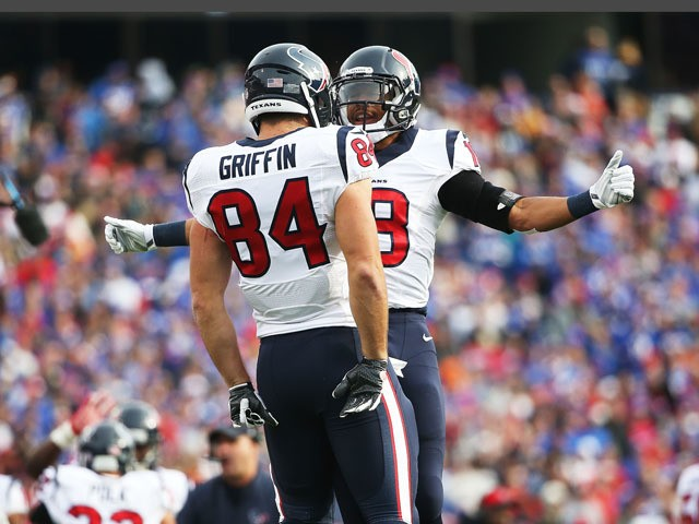 Ryan Griffin #84 of the Houston Texans celebrates a touchdown against the Buffalo Bills with Cecil Shorts #18 of the Houston Texans during the first half at Ralph Wilson Stadium on December 6, 2015