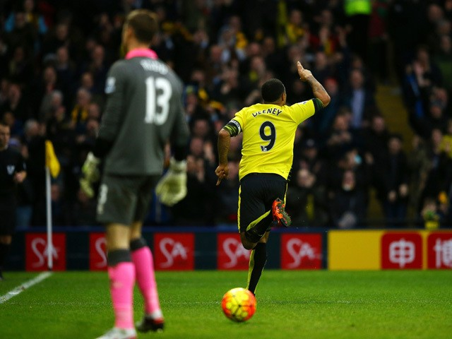 Troy Deeney of Watford celebrates scoring his team's first goal during the Barclays Premier League match between Watford and Norwich City at Vicarage Road on December 5, 2015