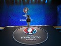 A picture shows the trophy of the UEFA Euro 2016 football tournament ahead of the final draw in Paris on December 12, 2016