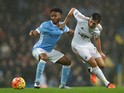 Raheem Sterling of Manchester City and Ki Sung-Yeung of Swansea City compete for the ball during the Barclays Premier League match between Manchester City and Swansea City at Etihad Stadium on December 12, 2015