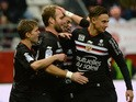 Nice's French forward Valere Germain (2nd L) is congratulated by teammates after scoring a goal during the French L1 football match between Reims and Nice at Auguste Delaune Stadium in Reims on December 12, 2015