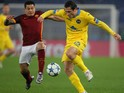 Juan Iturbe (L) of AS Roma competes for the ball with Maksim Zhavnerchik of FC BATE Borisov the UEFA Champions League group E match between AS Roma and FC BATE Borisov on December 9, 2015 in Rome, Italy.