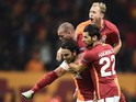 Galatasaray's Turkish midfielder and captain Selcuk Inan (L) celebrates with teammates after scoring a goal during the UEFA Champions League Group C football match between Galatasaray AS and FC Astana at the Turk Telekom Arena in Istanbul on December 8, 2