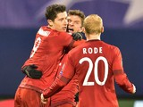 Bayern Munich's Polish striker Robert Lewandowski (L) celebrates scoring with Bayern Munich's midfielder Thomas Mueller and Bayern Munich's midfielder Sebastian Rode during the UEFA Champions League football match between Dinamo Zagreb v Bayern Munich at