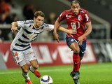 Lorient's French defender Vincent Le Goff (L) vies with Lille's French defender Djibril Sidibe during the French L1 football match between Lille OSC and FC Lorient on December 12, 2015 at the Pierre Mauroy Stadium in Villeneuve d'Ascq, northern france
