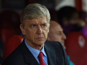sene Wenger of Arsenal looks on during the UEFA Champions League Group F match between Olympiacos FC and Arsenal FC at Karaiskakis Stadium on December 9, 2015 in Piraeus, Greece.