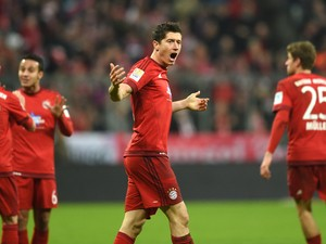 Bayern Munich's Polish striker Robert Lewandowski (C) celebrates scoring during the German first division Bundesliga football match FC Bayern Munich vs FC Ingolstadt 04 in Munich, southern Germany, on December 12, 2015