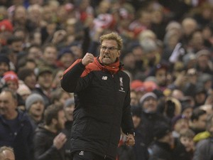 Liverpool's German manager Jurgen Klopp celebrates their late equalising goal to level the score at 2-2 the English Premier League football match between Liverpool and West Bromwich Albion at Anfield in Liverpool, northwest England, on December 13, 2015