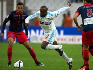 Marseille's French midfielder Lassana Diarra (C) vies with Ajaccio's Tunisian midfielder Mohamed Larbi (L) during the French L1 football match between Olympique de Marseille (OM) and Gazelec-Ajaccio on December 13, 2015 at the Velodrome stadium in Marseil