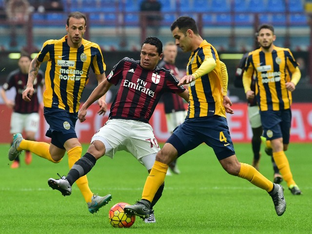 AC Milan's forward from Colombia Carlos Bacca (L) fights for the ball with Hellas Verona's defender from Mexico Rafael Marquez during the Italian Seria A football match AC Milan vs Hellas Verona at San Siro Stadium in Milan on December 13, 2015