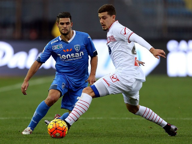Vincent Laurini of Empoli FC battles for the ball with Martinho Raphael of Carpi FC during the Serie A match betweeen Empoli FC and Carpi FC at Stadio Carlo Castellani on December 13, 2015 in Empoli, Italy.