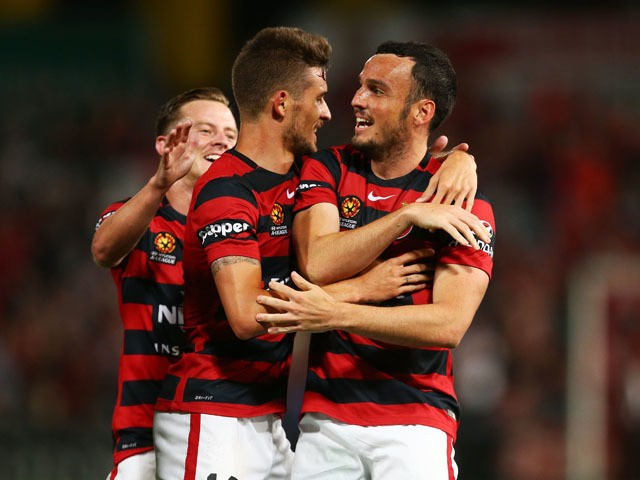 Mark Bridge (R) of the Wanderers celebrates with Dario Vidosic of the Wanderers (L) after scoring the first goal during the round 10 A-League match between the Western Sydney Wanderers and Melbourne Victory at Pirtek Stadium on December 12, 2015