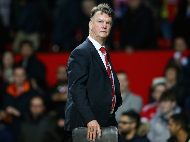 Manchester United boss Louis van Gaal leaves the pitch after watching his side fall 2-1 to Norwich on December 19, 2015