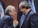 Sepp Blatter and Michel Platini gleefully shake hands in Zurich on May 29, 2015