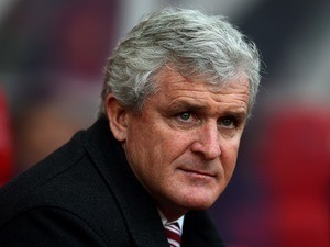 Mark 'Bah Humbug' Hughes watches on during the game between Manchester United and Stoke City on December 26, 2015
