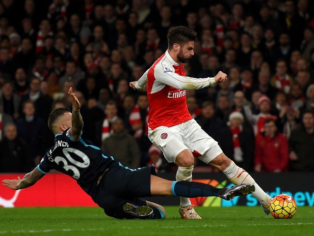 Olivier Giroud scores Arsenal's second goal during the 2-1 victory over Manchester City at the Emirates Stadium on December 21, 2015