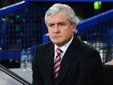 Stoke City boss Mark Hughes watches on during the game with Everton on December 28, 2015