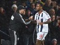 Saido Berahino shakes hands with Tony Pulis during the FA Cup game between West Brom and Bristol City on January 9, 2016
