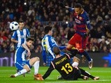 Barcelona's Neymar competes for the ball with Espanyol players during the Copa del Rey round-of-16 first leg at Camp Nou on January 6, 2016