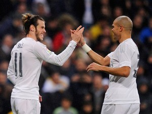 Gareth Bale celebrates with Pepe during the game between Real Madrid and Deportivo La Coruna on January 9, 2016