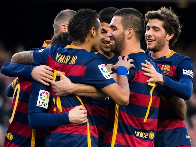 Barcelona players celebrate during the game with Granada on January 9, 2016