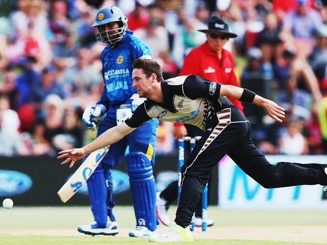 Matt Henry fields off his own bowling during the Twenty20 match between New Zealand and Sri Lanka at Bay Oval on January 7, 2016