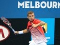 Dan Evans plays a forehand in his match against Amir Weintraub during the second round of 2016 Australian Open Qualifying at Melbourne Park on January 14, 2016