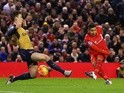 Roberto Firmino of Liverpool scores his team's first goal against Arsenal at Anfield on January 13, 2016