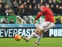 Wayne Rooney of Manchester United scores their third goal during the Premier League match against Newcastle United at St James' Park on January 12, 2016