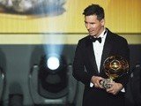 Lionel Messi receives the Ballon d'Or during the FIFA Ballon d'Or Gala 2015 at the Kongresshaus on January 11, 2016