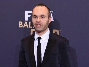 Andres Iniesta of Barcelona and Spain happily poses for photographs at the FIFA Ballon d'Or Gala 2015 at the Kongresshaus on January 11, 2016