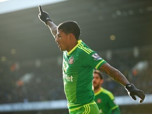 Patrick van Aanholt celebrates during the game between Spurs and Sunderland on January 16, 2016