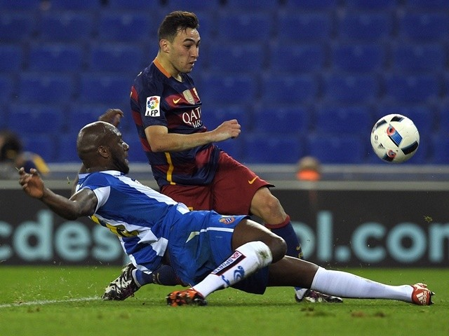 Barcelona's Munir El Haddadi shoots to score a goal next to Espanyol's French defender Michael Ciani on January 13, 2016