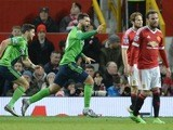 Charlie Austin celebrates after scoring the winner for Southampton at Old Trafford on January 23, 2016