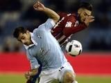 Celta Vigo's Jonny Castro vies with Atletico Madrid's Yannick Ferreira Carrasco on January 20, 2016