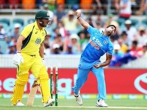 Umesh Yadav of India bowls against Australia at Manuka Oval on January 20, 201