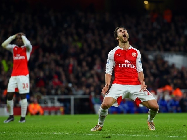 Mathieu Flamini of Arsenal reacts to a missed opportunity against Chelsea on January 24, 2016