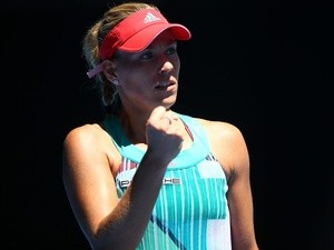Angelique Kerber celebrates winning a point in her fourth-round match against Annika Beck during day eight of the 2016 Australian Open at Melbourne Park on January 25, 2016
