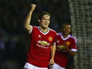 Daley Blind celebrates as he scores during the FA Cup fourth-round match between Derby County and Manchester United at iPro Stadium on January 29, 2016